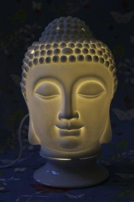 Boeddha lamp en geuroliebrander